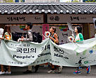 Seoul, South Korea. 21 September 2014. People who participate in People's Climate March walk in city center of Seoul where 100,000 people from across the globe have gathered to protest climate change. Several international organisations have joined efforts to raise awareness of the severity of the threat facing the planet due to climate change and hope to influence The United Nations Climate Change Conference or COP21 to be held in Paris, France in 2015.